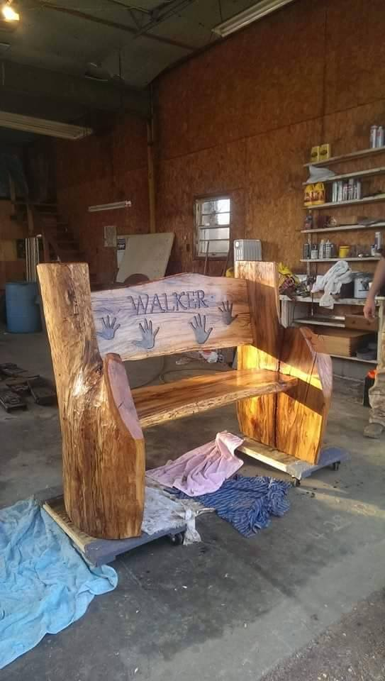 From Becca Walker: My boyfriend made this bench for my parents from an old oak tree. The hand prints are mine, my sister and my two boys.