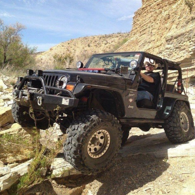 From Mickey Perritt: Me and Max, my 2000 TJ.