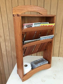 From Ron Boe‎: Magazine rack for the bathroom. Desperately needed! Main wood is poculi, bloodwood trim (to cover a mistake, naturally) and ebony pegs and faux pegs. Influenced heavily by Green & Green. Shellac sanding sealing, spray lacquer finish.