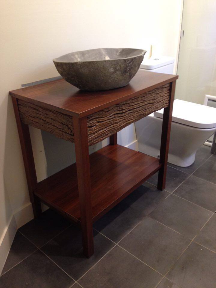 From Brad Davies: Made a vanity out of a 8 x 8 fence post, some jarrah flooring and s verandah post.