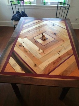 From Curtis Girginoff: Pallet wood dining table with black walnut border and purple heart accent pieces.