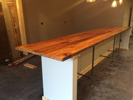 From Eric Edwards: Built this bar for a company called Silverhand Meadery in Williamsburg Va, from Heart Pine reclaimed from a NC tabacco barn built in 1873. Top has a dozen coats of helms wood clear, of which the first two were hand wiped on.