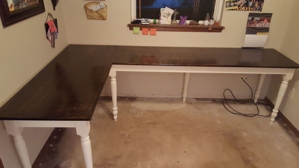 From Matt Wilson: Made this L shape desk for my mom. Made out of wood from the big box store. Used antique white paint for the skirt and legs. Stain and finished with polyurethane on the top.