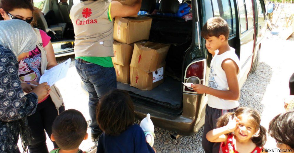 """Caritas Lebanon distribute aid to Syrian refugees living in the Qab Elials camp in Lebanon's Bekka Valley."" / Via Troicare"