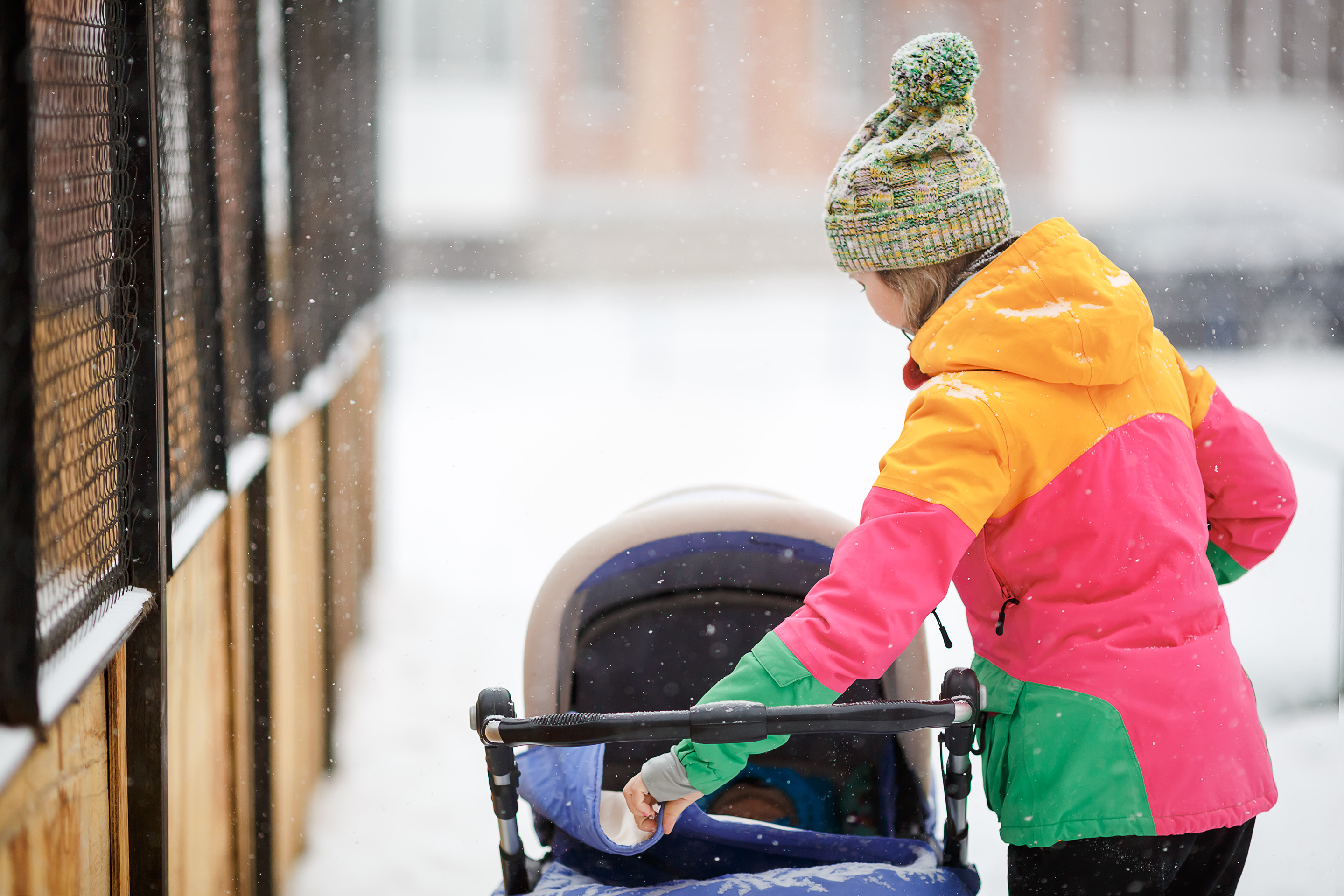 Mom and baby in stroller winter