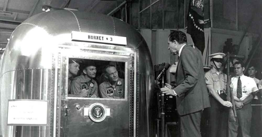 President Nixon talks to the crew of Apollo 11 from outside of their Airstream / Via NASA