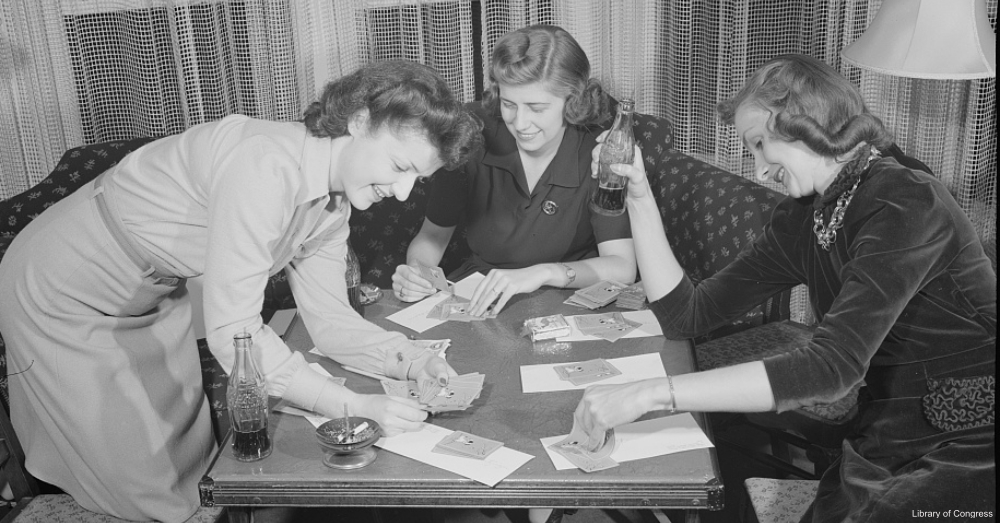Ladies at Card Game Drinking Coca Cola