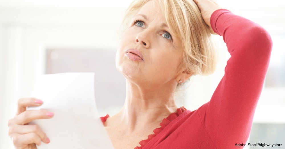 Mature Woman Experiencing Hot Flush From Menopause