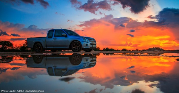 Car and sunset sky
