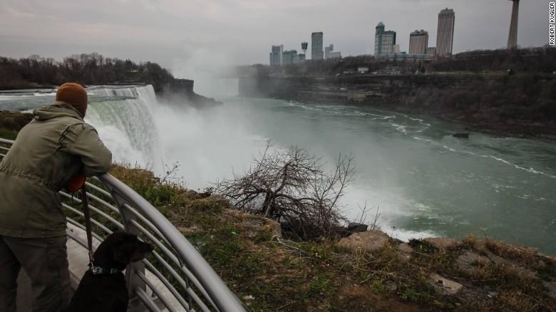 Kugler and Bella watching the water flow at Niagara Falls. (Credit: Robert Kugler)