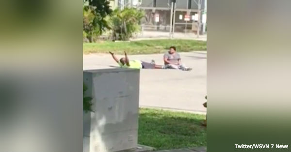Charles Kinsey lays in the street next to the man with autism he went out to help, moments before he is shot by police.