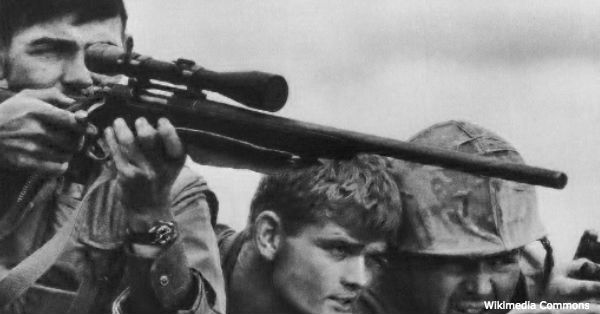 A Marine Corps sniper team searches for targets in the Khe Sanh Valley.