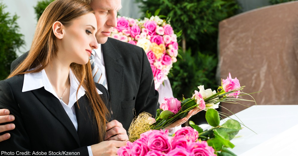 Mourning People at Funeral with coffin