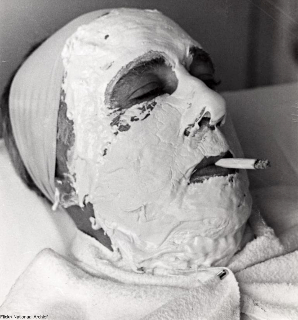 1941 Man Smoking a Cigarette While He Gets a Facial Treatment