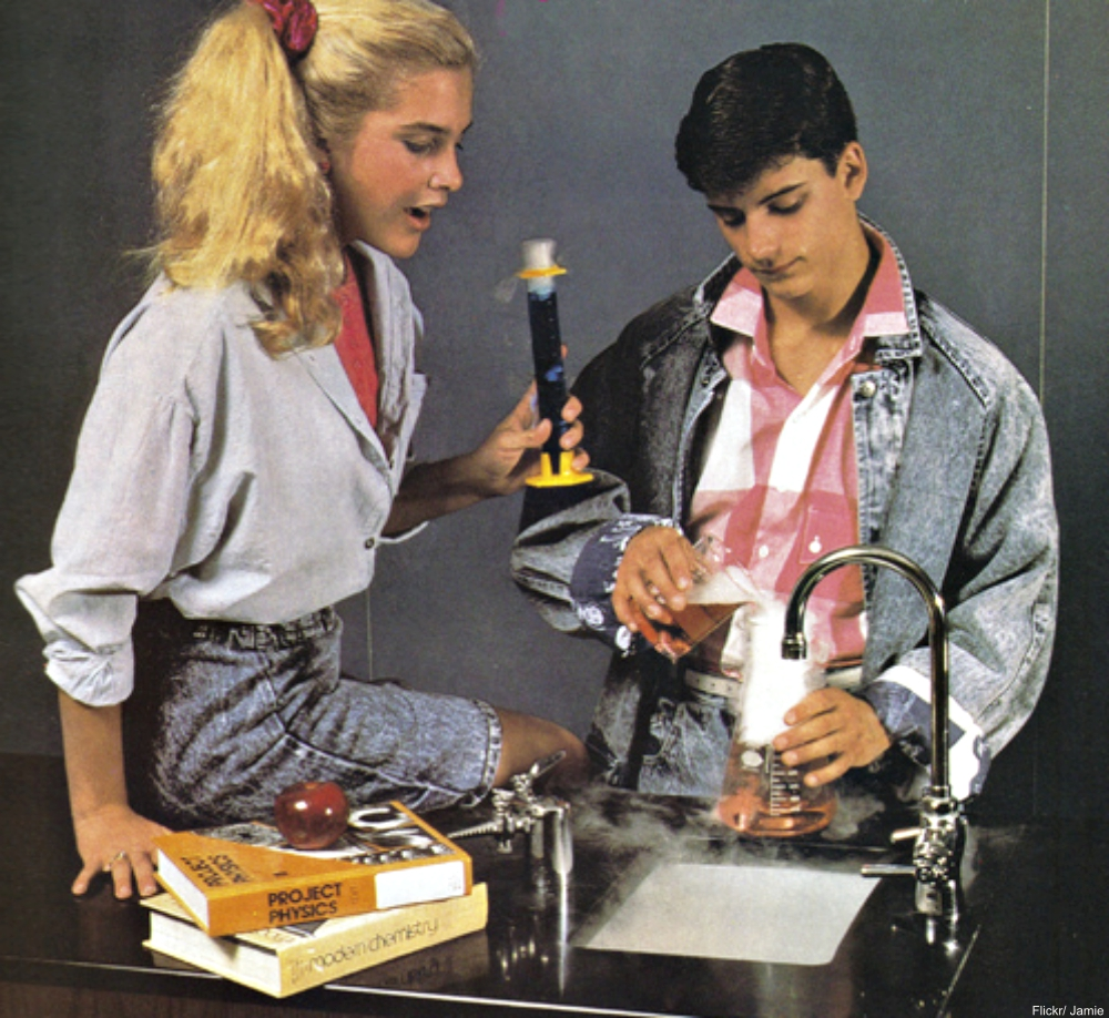 80s kids doing chemistry experiment  in denim clothing