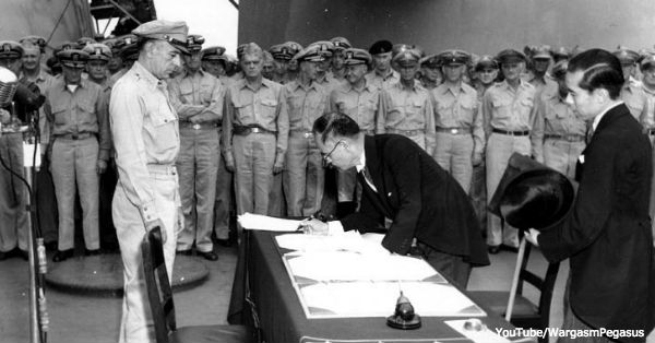 Japanese foreign affairs minister Mamoru Shigemitsu signs the Japanese Instrument of Surrender on board USS Missouri.