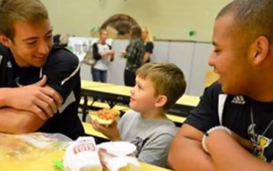Football stars Chris and Mark share lunch with a bullied kindergartner