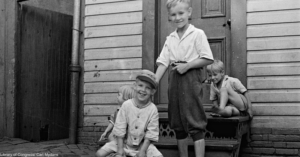 boys playing on steps 1930s