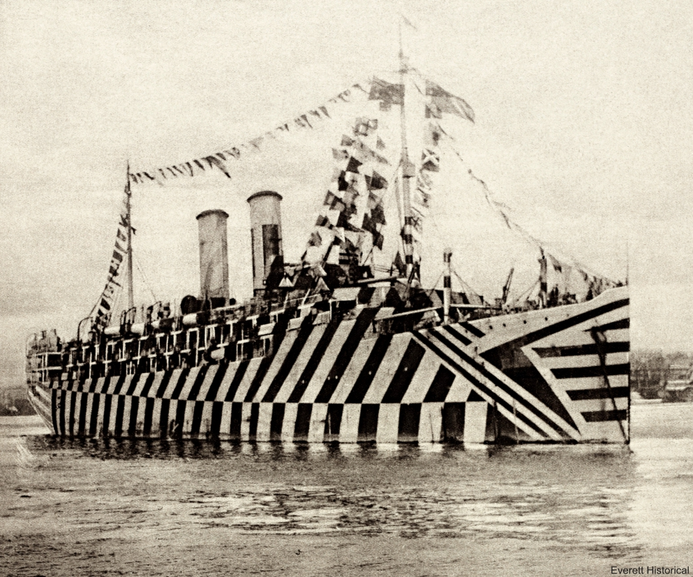 British WW1 transport Osterle camouflaged with Zebra stripes. Nov. 11, 1918. In New York Harbor, she was decked with flags to celebrate the armistice.
