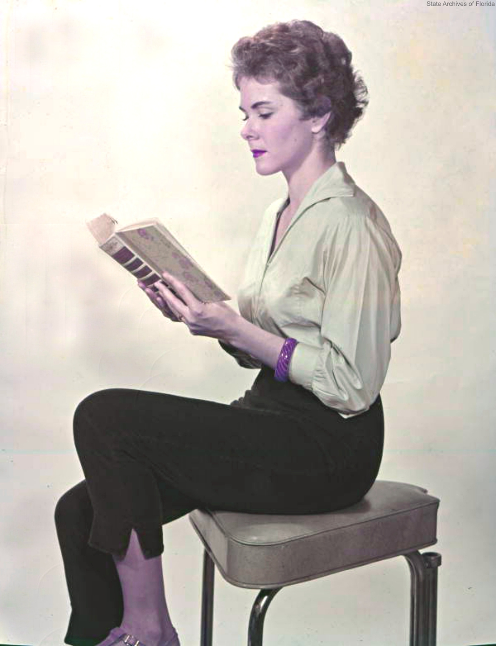 Young woman reading 1958