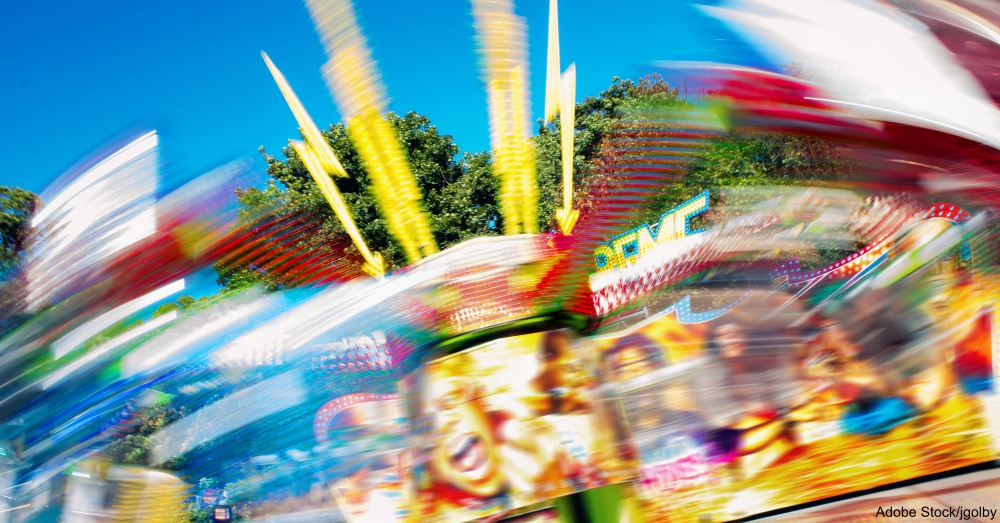 Colorful Extreme Fairground Ride. Spinning Motion Blur Fun Fair