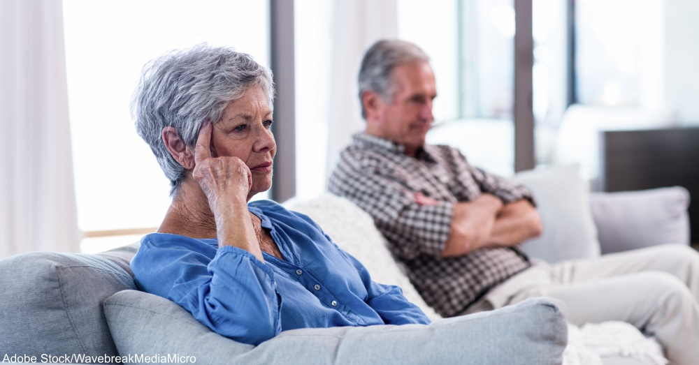 Upset senior couple ignoring each other