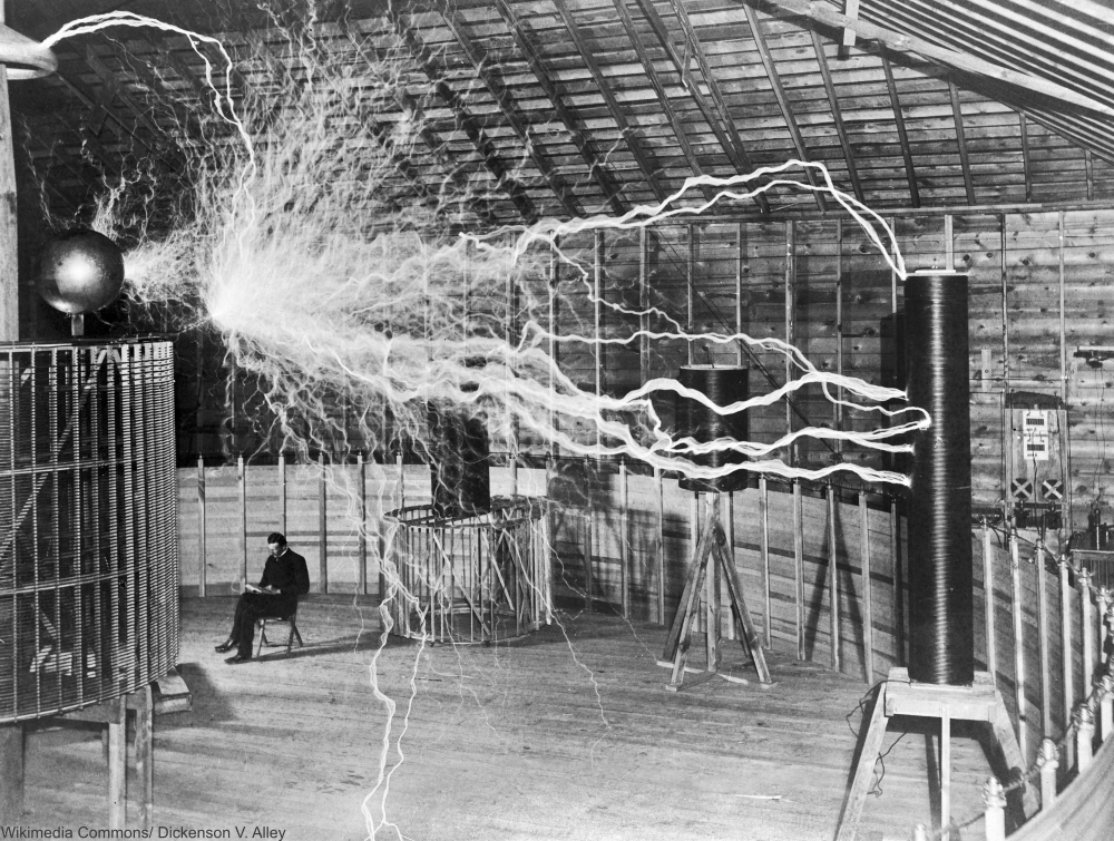 Double exposure of Nikola Tesla with his equipment