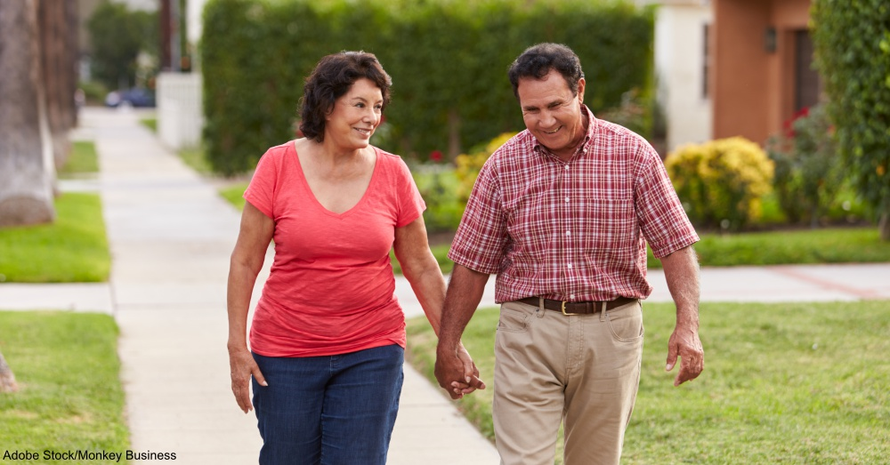Couple Walking Along Sidewalk Together