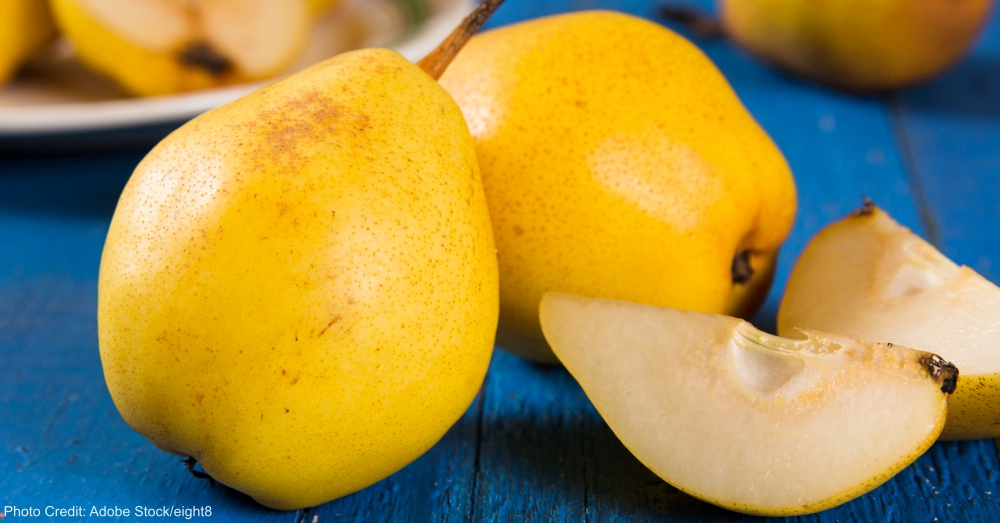 Fresh ripe organic yello pears on blue rustic wooden table, natural background, diet food.
