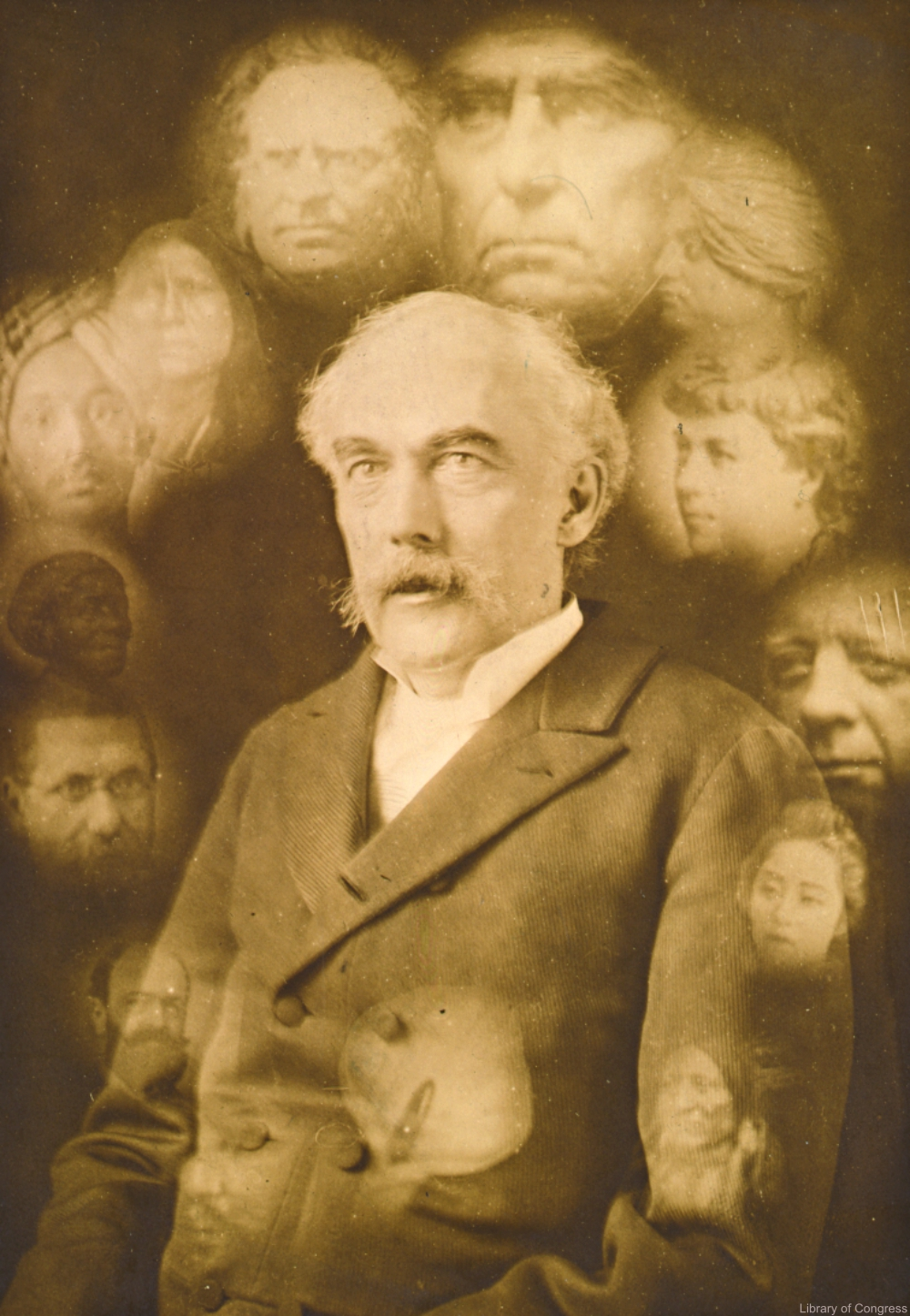 [Spirit photograph showing half-length portrait of John K. Hallowell, facing left, surrounded by super-imposed faces of fourteen deceased people