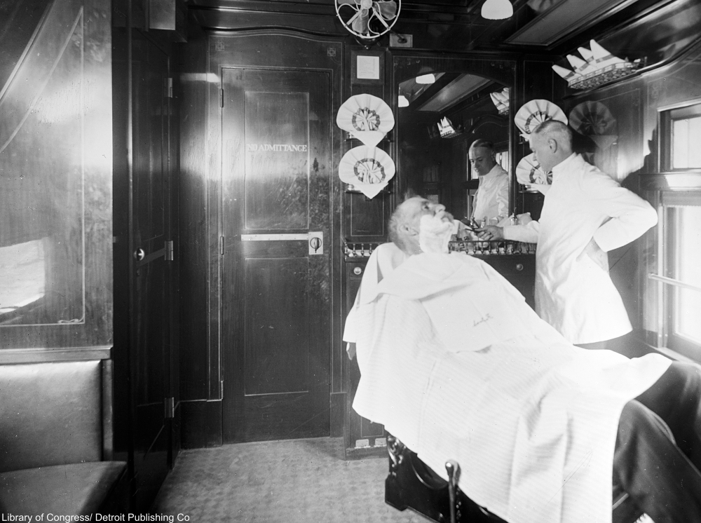 Deluxe overland limited train barber shop car, 1910s.