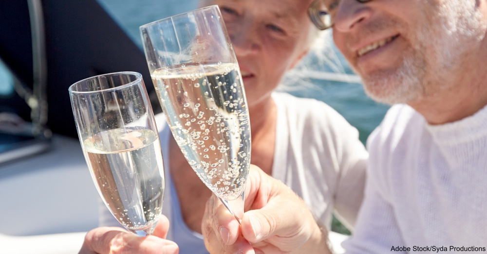 close up of senior couple with champagne on boat