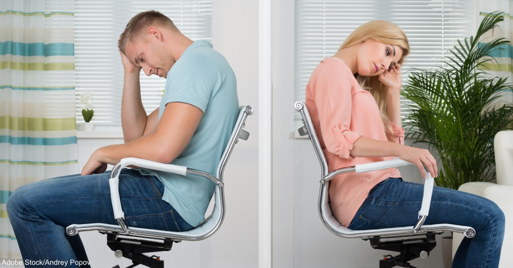 Upset Couple Sitting On Chairs At Home