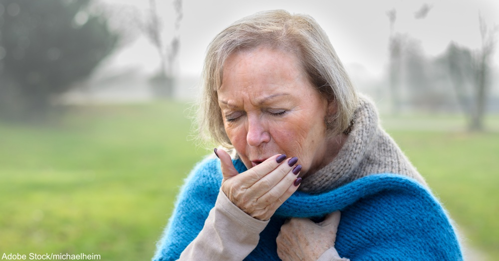 Elderly stylish woman coughing or sneezing