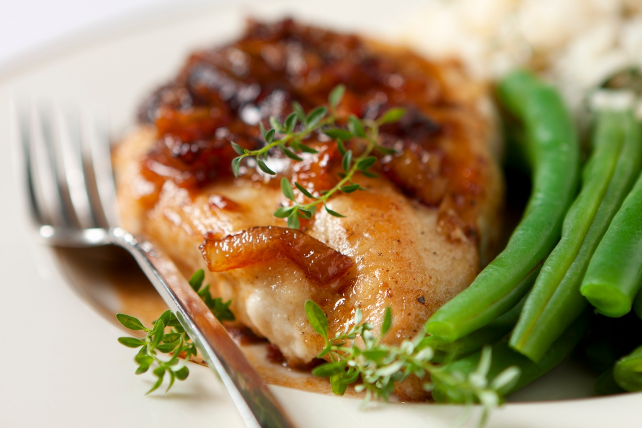 A boneless chicken breast with a Marsala wine sauce.