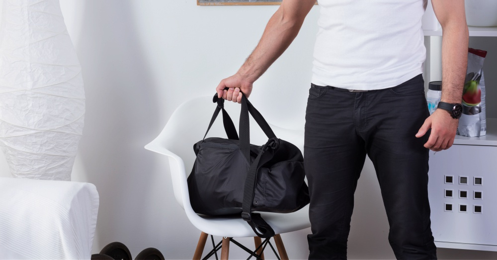 Fit man with gym bag