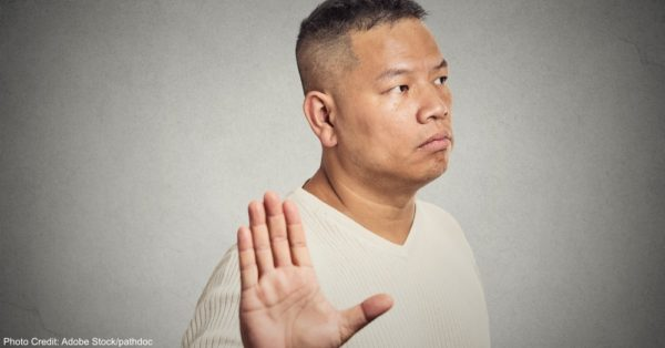 grumpy middle aged man bad attitude giving talk to hand gesture