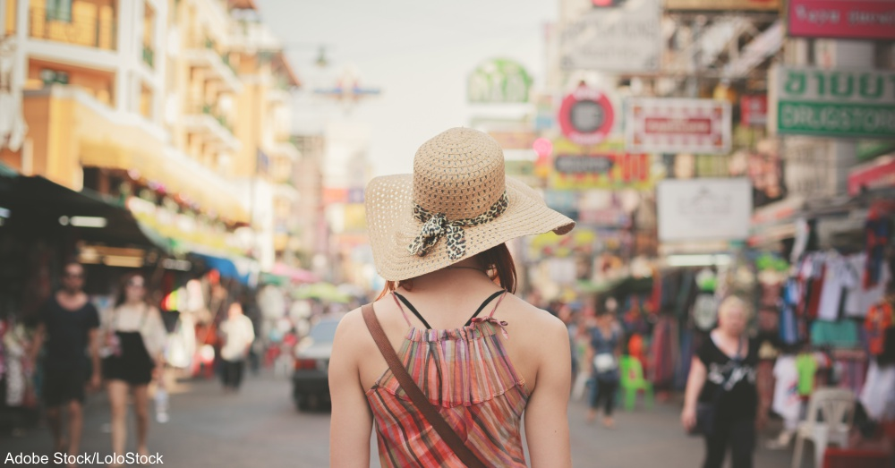 Young woman walking in Khao San, Bangkok