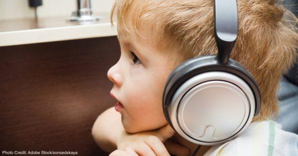 Portrait of a beautiful little boy in headphones