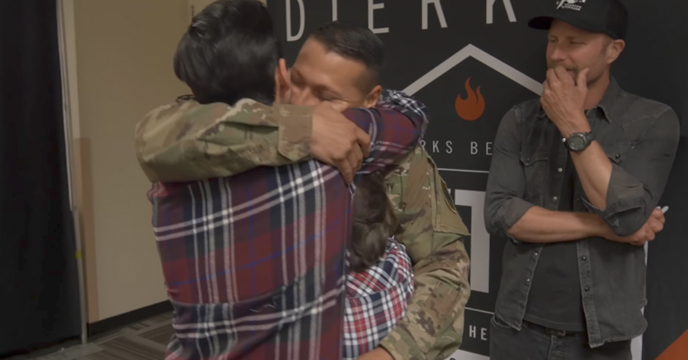 Photo: YouTube/Dierks Bentley -- Staff Sgt. Steven Mendez gets a big hug from his sons after being deployed for 10 months.