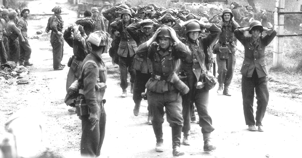 Photo: Wikimedia Commons -- German soldiers surrendering after the Battle of Normandy.
