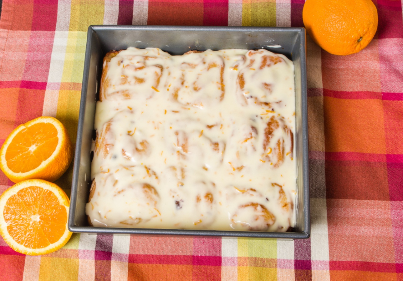 Fresh orange cinnamon rolls with icing