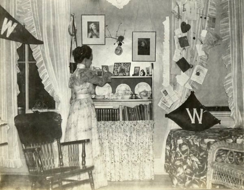 this-womans-dorm-room-from-1898-isnt-much-different-from-modern-day-dorms-pennants-books-and-a-chair-for-studying
