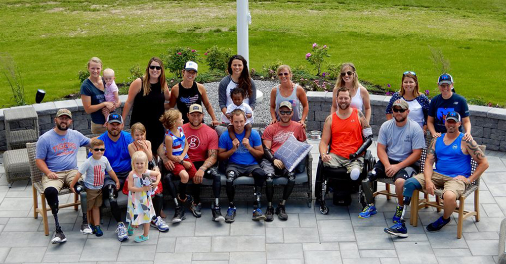 Photo: Facebook/SSG Travis Mills -- The first guests at The Maine Chance Lodge & Retreat celebrated Independence Day together.