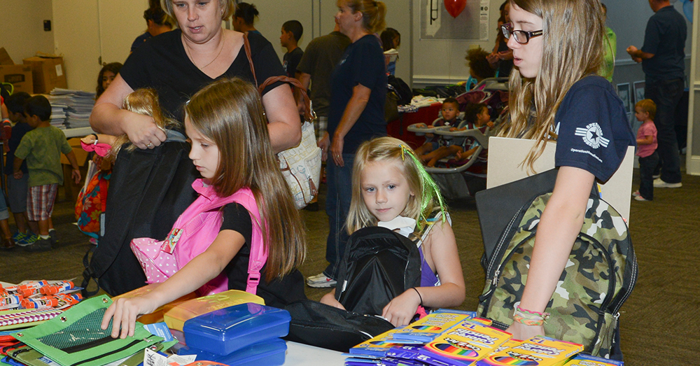 Photo: Air National Guard/Senior Master Sgt. Elizabeth Gilbert -- Military families browse through school supply items with new backpacks.