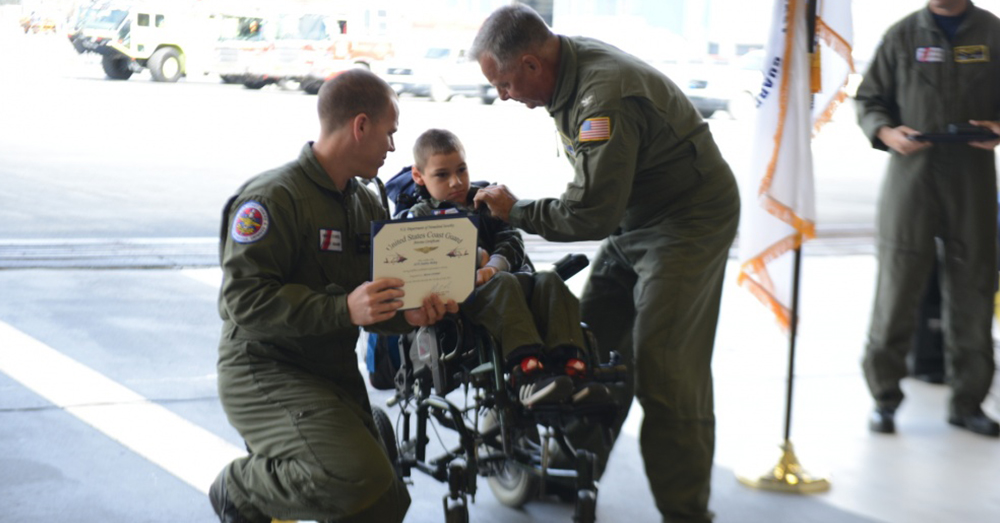 Photo: U.S. Coast Guard/Petty Officer 2nd Class Meredith Manning -- Andrew Bishop, 8, receives an Air Medal after completing his search and rescue mission.