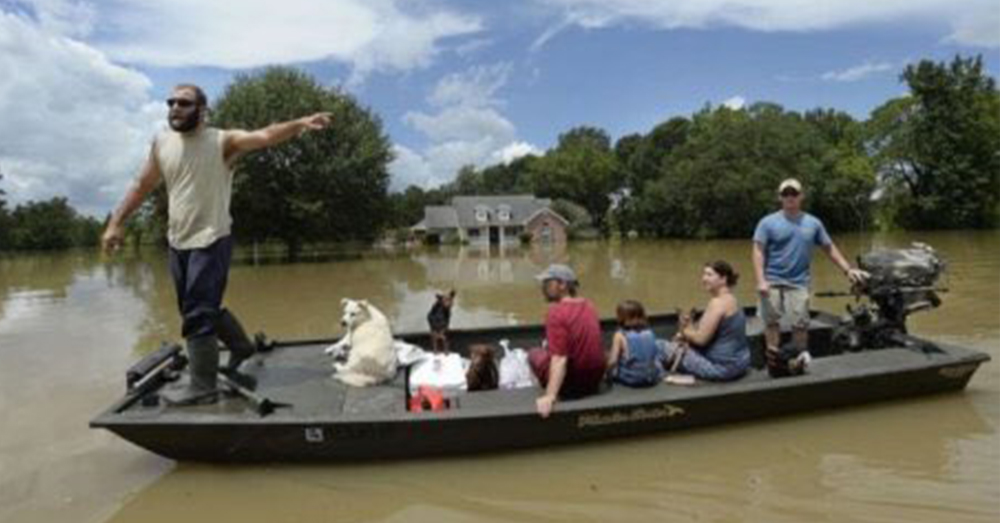 Photo: Twitter/ABC News -- The Cajun Navy helps rescue people and their pets in flooded Houston.