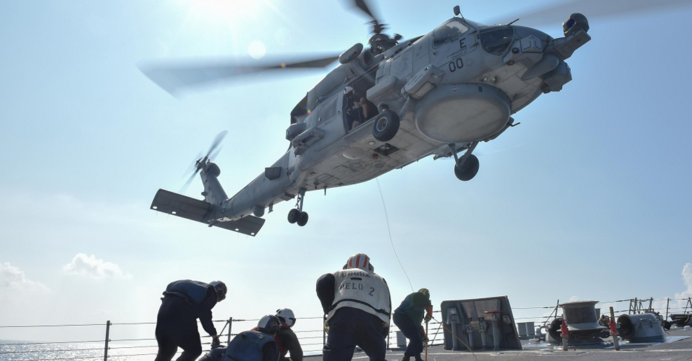 Photo: U.S. Navy/Mass Communication Specialist 2nd Class Corey T. Jones -- A Seahawk helicopter takes off from a 7th Fleet vessel.