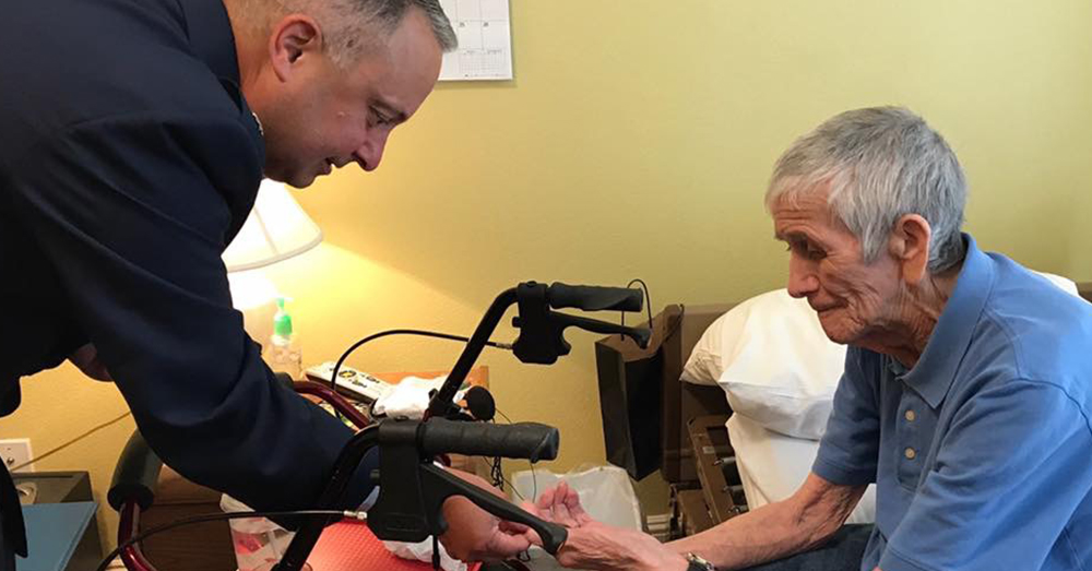 Photo: Facebook/Julie Dunn -- Lt. Col. Andy LaFrazia gives Lawrence Silk a challenge coin from the unit they both served in.