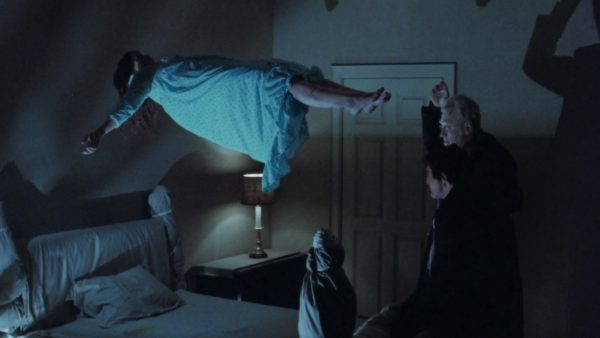 A possessed Regan floats over her bed in the classic film